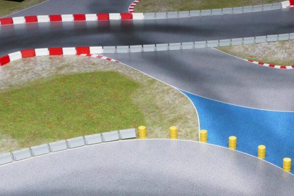 Streckenbegrenzung betongrau kombiniert mit rot / weiss auf Rollrennstrecke