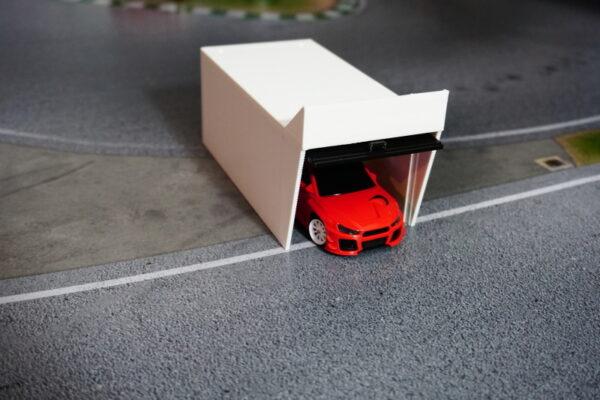 boxengarage-betongrau-mit-tor-2